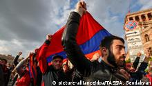 Protesters carry the Armenian flag during demonstrations in Yerevan