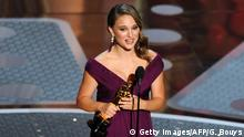 Actress Natalie Portman holds the trophy for Best Actress in a Motion Picture for her role in Black Swan at the 83rd Annual Academy Awards at the Kodak Theatre late on February 27, 2011 in Hollywood, California. AFP PHOTO / GABRIEL BOUYS (Photo credit should read GABRIEL BOUYS/AFP/Getty Images)