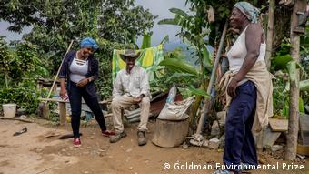 Two women and a man laugh together (Goldman Environmental Prize)
