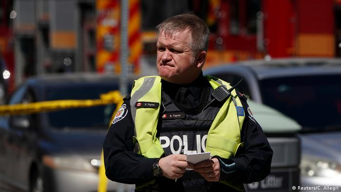 A pedestrian officer responds to an incident where a van struck multiple people in Toronto. (Reuters/C. Allegri)