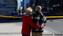 An elderly couple embraces as they look on to the scene of Toronto vehicle rampage (Reuters/C. Donovan)