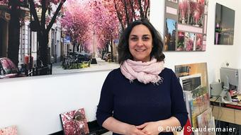 Victoria Harlos, the owner of Print & Paint speaks with DW