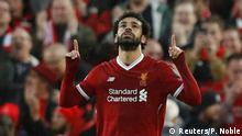 Soccer Football - Champions League Semi Final First Leg - Liverpool vs AS Roma - Anfield, Liverpool, Britain - April 24, 2018 Liverpool's Mohamed Salah celebrates scoring their first goal REUTERS/Phil Noble