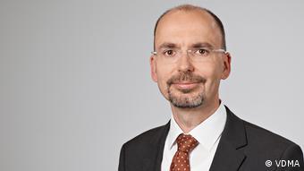 Matthias Zelinger wearing a suit and tie