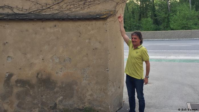 Photo: A man points to a wall in Melk, Austria (Source: Bob Berwyn)