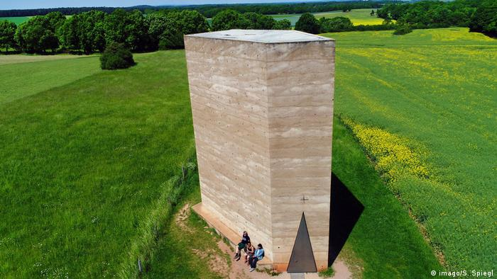 Bruder-Klaus-chapel, a tall cement building in a field