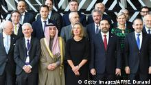 (1st row LtoR) United Nations Special Envoy for Syria Staffan de Mistura, UN Under-Secretary General for Humanitarian and Affairs and Emergency Relief Coordinator Mark Lowcock, Saudi Arabia Foreign Minister Adel Bin Ahmed Al-Jubeir, European Union Foreign policy chief Federica Mogherini, Lebanon's Prime Minister Saad Hariri, and Jordan's Foreign Minister Ayman al-Safadi pose for a family photo during a conference on Supporting the future of Syria and the region at the European Council in Brussels on April 25, 2018. - The EU on April 25, 2018 urged Russia and Iran to pressure Damascus to engage in talks to end Syria's bloody civil war, as international donors pledged billions of dollars to help civilians caught up in the conflict. More than 80 countries, aid groups and United Nations agencies are meeting in Brussels for the second day of a conference on the future of Syria, after the UN's special envoy warned of a looming humanitarian catastrophe in the rebel-held region of Idlib. (Photo by Emmanuel DUNAND / AFP) (Photo credit should read EMMANUEL DUNAND/AFP/Getty Images)