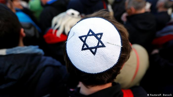 A man wears a yarmulke during a demonstration in front of a Jewish synagogue in Berlin