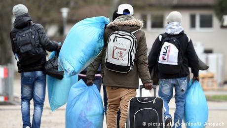 Refugees with luggage