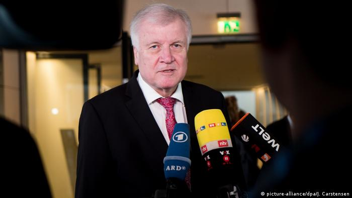 Horst Seehofer speaking to journalists