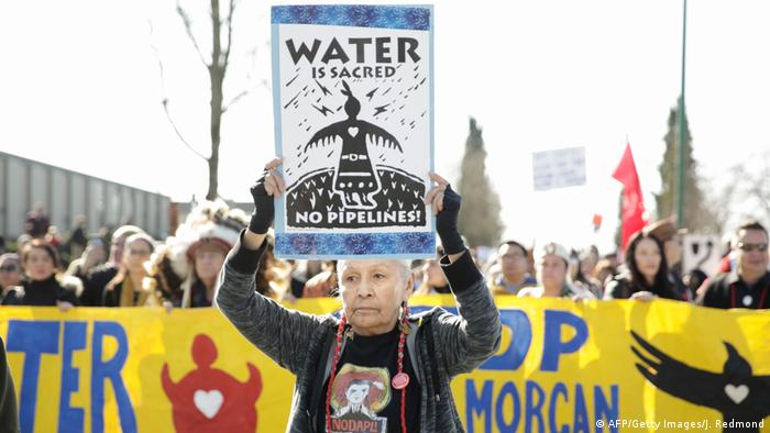 An Anishinaabe protestor marches against oil pipeline development in Canada