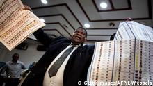 Independent National Electoral Commission (CENI) official, Jean-Pierre Kalamba holds up lists of candidates during a presentation showing how new voting machine work, on February 21, 2018 in Kinshasa. DR Congo's long-delayed election due next December 23 to choose a successor to long-serving ruler Joseph Kabila will not take place without electronic voting machines, the poll chief said today. / AFP PHOTO / John WESSELS (Photo credit should read JOHN WESSELS/AFP/Getty Images)