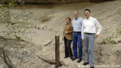 Merkel mit Ehemann zu Besuch auf George W. Bushs Ranch in Texas (picture-alliance/dpa/S. Kugler)
