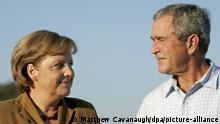 U.S. President George W. Bush (R) and German Chancellor Angela Merkel smile during their remarks following Merkel's arrival at the Bush's ranch in Crawford Texas USA on 09 November 2007. Merkel and Bush are expected to discuss the situation in Iran during her visit. EPA/MATTHEW CAVANAUGH +++(c) dpa - Report+++ |