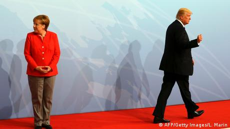 German Chancellor Angela Merkel and US President Donald Trump gesture at the beginning of the G20 meeting in Hamburg