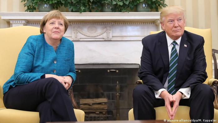 Donald Trump not shaking hands with Angela Merkel's hand (picture-alliance/dpa/M. Kappeler)