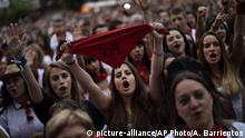 FILE - In this Monday, July 11, 2106 file photo, people protest against alleged sexual assaults during the San Fermin festival in Pamplona, northern Spain. A Spanish court on Tuesday Nov. 28, 2017 is hearing final arguments from lawyers and defendants in an alleged gang rape case that has gripped Spain and triggered criticism over how cases involving alleged abuse of women are handled. The case centers around a woman's allegation that she was gang raped by five men during the Pamplona's San Fermin bull-running, street partying festival in July 2016. Words read in Basque No to sexual assaults. (AP Photo/Alvaro Barrientos, File) |