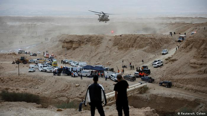 Rescue helicopter searches for survivors near Zafit river bed