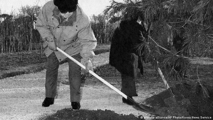 North Korean leader Kim Jong Il planting a tree in 2004.