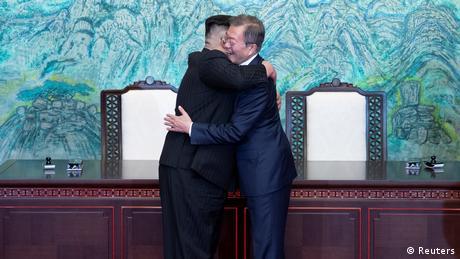 South Korean President Moon Jae-in and North Korean leader Kim Jong Un embrace (Reuters)