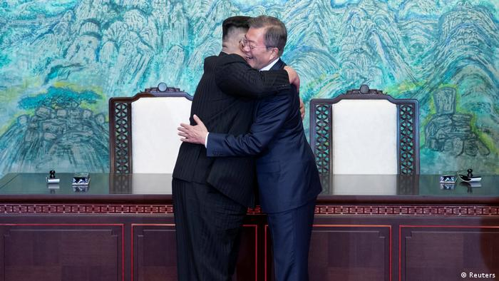 South Korean President Moon Jae-in and North Korean leader Kim Jong Un embrace (Reuters)