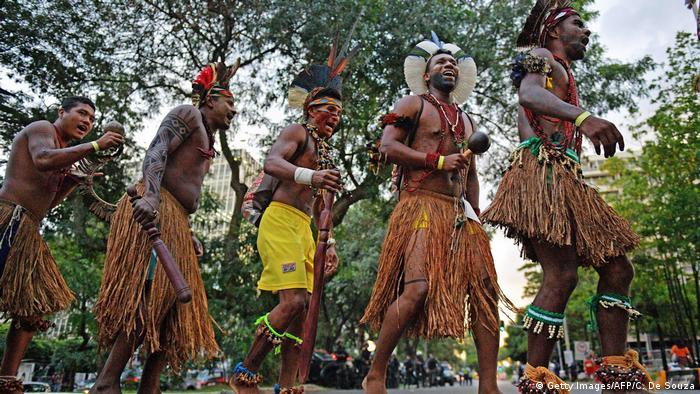 Indigenous men protest Brazil's proposed land policies (Source: Getty Images/AFP/C. De Souza)