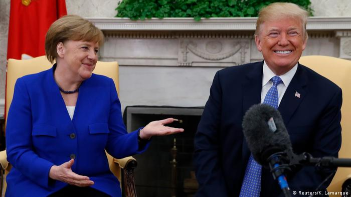 President Donald Trump and Chancellor Angela Merkel smile for the press (Reuters/K. Lamarque)