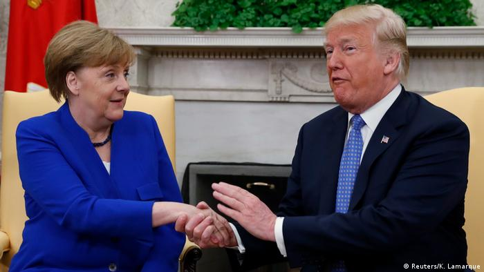 Angela Merkel shakes hand with Donald Trump (Reuters/K. Lamarque)