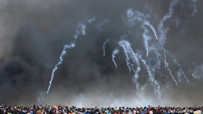 Israeli tear gas canisters fly towards Palestinian crowds (Reuters/I.A. Mustafa)