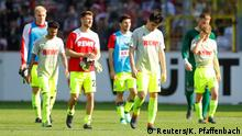 28.04.2018 Soccer Football - Bundesliga - SC Freiburg v FC Cologne - Schwarzwald-Stadion, Freiburg, Germany - April 28, 2018 Cologne's Jorge Mere and team mates look dejected at the end of the match REUTERS/Kai Pfaffenbach DFL RULES TO LIMIT THE ONLINE USAGE DURING MATCH TIME TO 15 PICTURES PER GAME. IMAGE SEQUENCES TO SIMULATE VIDEO IS NOT ALLOWED AT ANY TIME. FOR FURTHER QUERIES PLEASE CONTACT DFL DIRECTLY AT + 49 69 650050