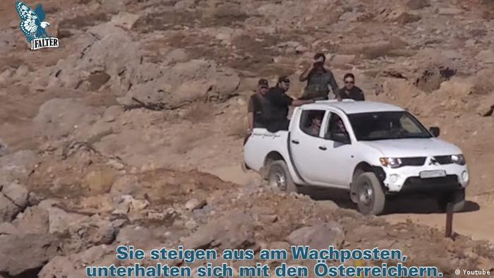Screenshot of Falter video: 'Syrian police officers arriving in a jeep'