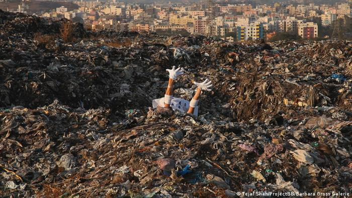 a pile of garbage with two arms sticking out (Tejal Shah/ProjectBB/Barbara Gross Galerie)