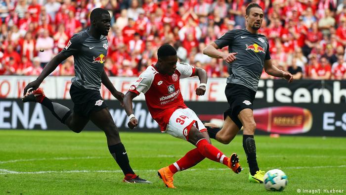Mainz's Ridle Baku beats RB Leizig's Dayot Upamecano to score in the Bundesliga