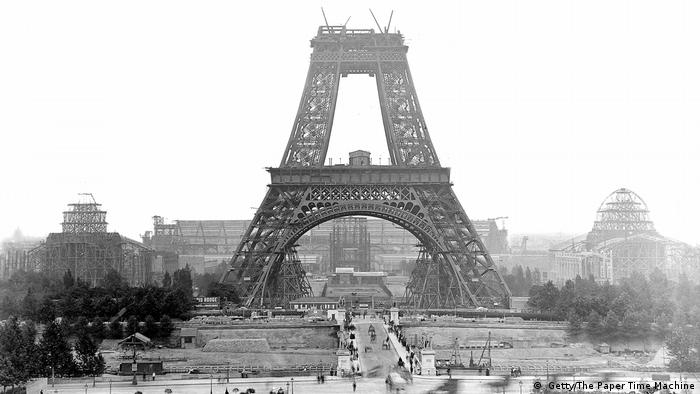 Historical photo from 1888 shows the Eiffel Tower under construction with the two lower tiers having been completed.
