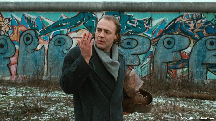 man views hand by Berlin Wall (Studiocanal/Arthaus)