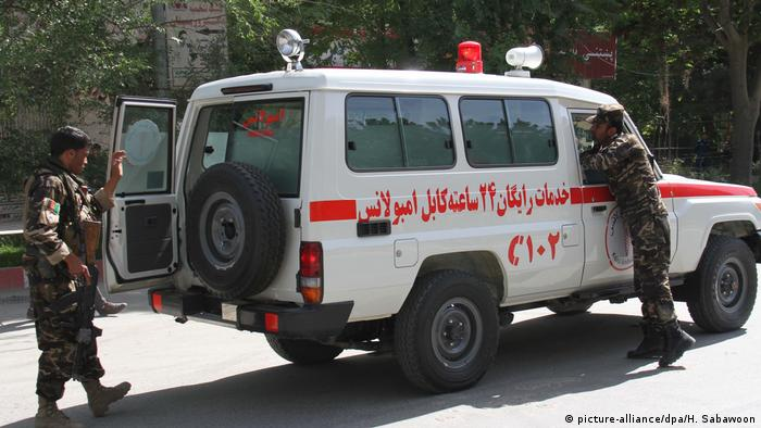 An ambulance arrives at the scene after twin explosions targeted central Kabul