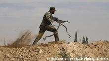 A Shiite figher in Syria (picture-alliance/AP Photo/J.al-Helo)
