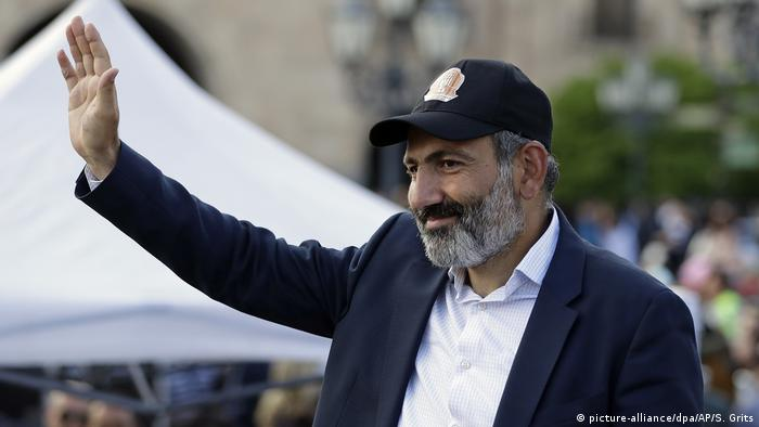 Pashinian gestures during a rally
