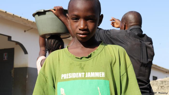 Young Gambian person with a T-shirt supporting ex-President Yahya Jammeh (DW/F. Muvunyi)
