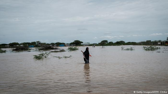 A woman walks through floodwaters in north-east Kenya