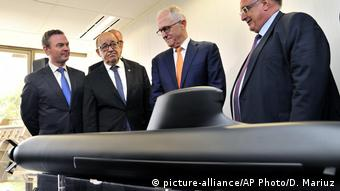 Australian and French officials inspecting the sumbarine model in 2016