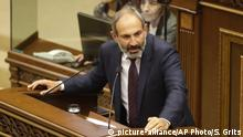 Opposition lawmaker Nikol Pashinian speaks during a parliament session to choose a replacement of Prime Minister in Yerevan on Tuesday, May 1, 2018. Nikol Pashinian, the opposition lawmaker who sparked two weeks of protests that threw Armenia into a political crisis, so far is the only candidate formally nominated for the prime minister's post. (AP Photo/Sergei Grits)  