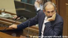 Opposition lawmaker Nikol Pashinian pauses during a parliament session to choose a replacement of Prime Minister in Yerevan on Tuesday, May 1, 2018. Nikol Pashinian, the opposition lawmaker who sparked two weeks of protests that threw Armenia into a political crisis, so far is the only candidate formally nominated for the prime minister's post. (AP Photo/Sergei Grits)  