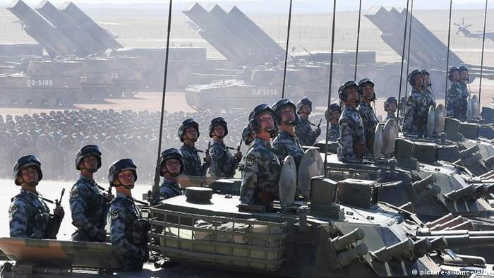 Chinese soldiers take part in a military parade
