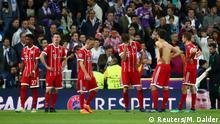 Soccer Football - Champions League Semi Final Second Leg - Real Madrid v Bayern Munich - Santiago Bernabeu, Madrid, Spain - May 1, 2018 Bayern Munich players look dejected after the match REUTERS/Michael Dalder