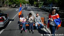 02,05,2018+++ Armenian opposition supporters sit on bench as they block a road after protest movement leader Nikol Pashinyan announced a nationwide campaign of civil disobedience in Yerevan, Armenia May 2, 2018. REUTERS/Gleb Garanich