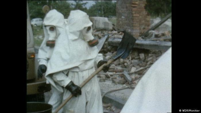 Men in gas masks