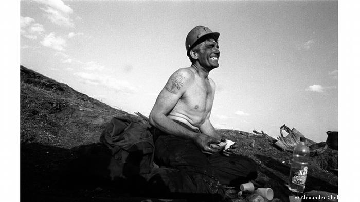 image of a miner with a black face (Alexander Chekmenev )