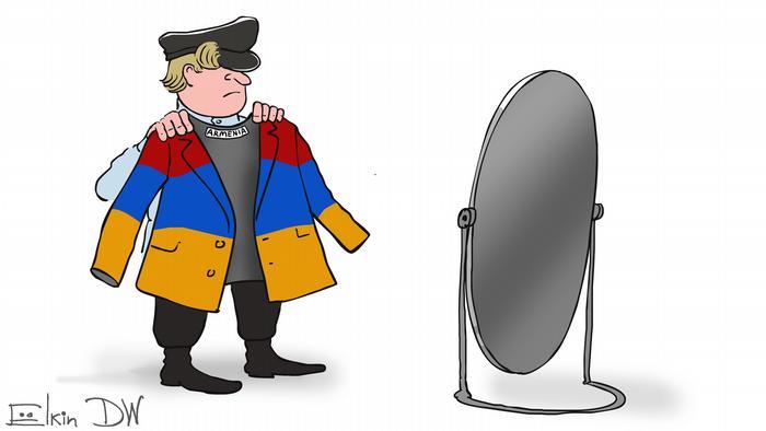 Человек примеряет перед зеркалом костюм в цветах армянского флага