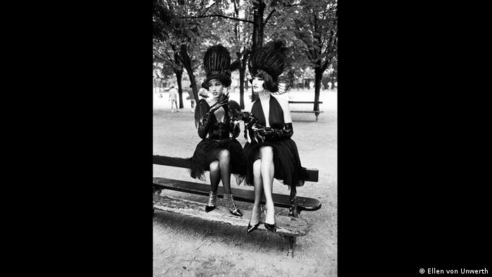 two women sitting atop a park bench (Ellen von Unwerth)